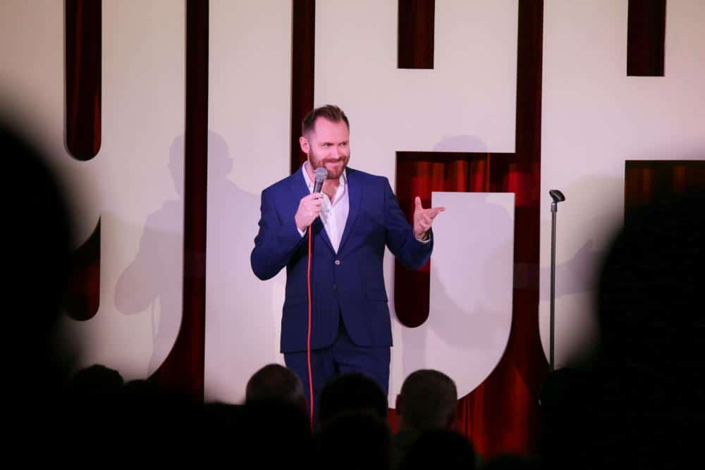 Ultra Comedy Comedian on stage during their set.